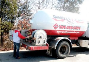 employee by Quality Propane truck